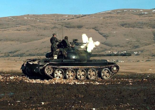 HVO_Army_T-55_Glamoc_firing_MG.jpg