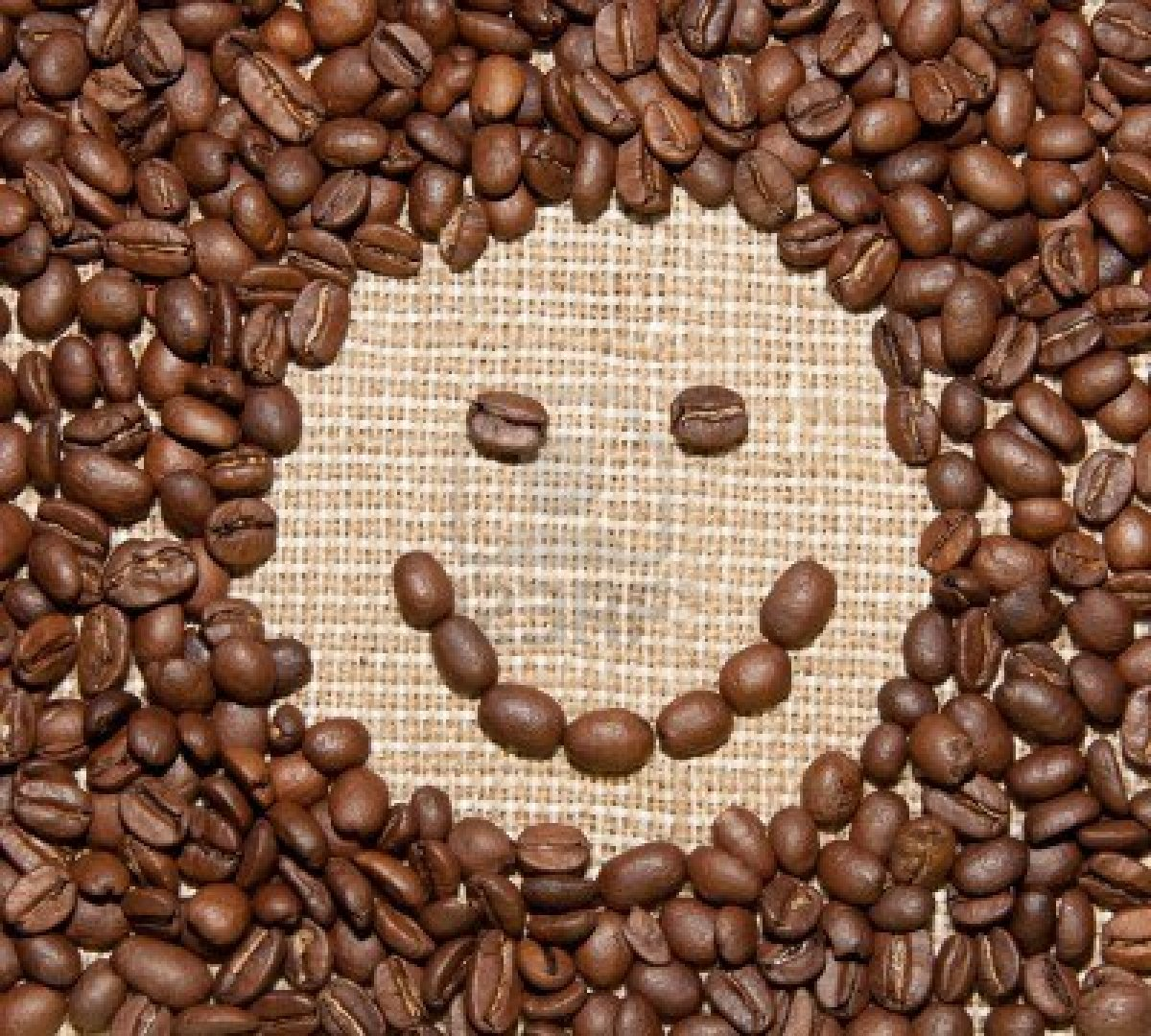 10201646-coffee-beans-smile-on-burlap-background.jpg