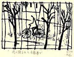 雨の降る日に自転車で